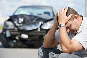 Man-with-wrecked-car